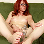 Baby oil fun. Wendy Summers oils up her anatomy